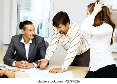 Young businessmen discussing a project
