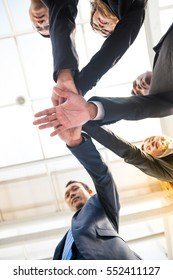 Young Businessmen handshake view from the bottom up