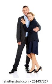 Young businesspeople embracing each other