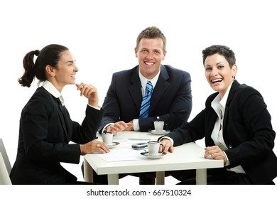 Young businesspeople having a coffee break, sitting at table. Isolated on white background.