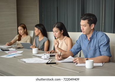 young businesspeople, man and woman, working in the meeting room, selective focus