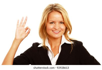 Young businesswoman approving something with ok sign isolated on white background