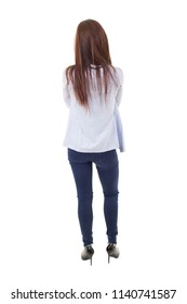 young businesswoman back view, full length, isolated