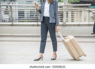 young businesswoman with baggage in city