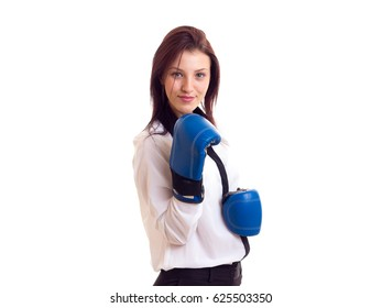 Young businesswoman in boxing gloves
