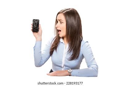 Young businesswoman with broken smartphone.