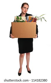 Young businesswoman carrying belongings after loosing employment