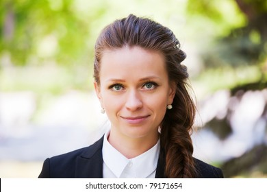 Young businesswoman in a city park
