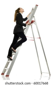 young businesswoman climbing a ladder on white background studio