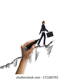 Young businesswoman climbing the mountain. Promotion concept
