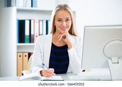 Young businesswoman with computer in the office
