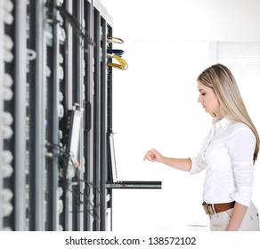 Young businesswoman and datacenter server room