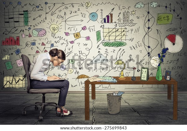 Young businesswoman executive working on laptop in office. Corporate investment consultant analyzing company annual financial report balance sheet statement documents graphs. Economy concept