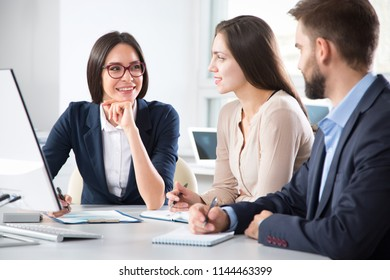 Young businesswoman explains to colleagues a new project