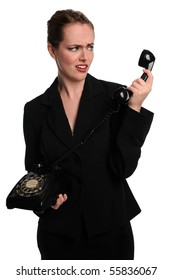 Young Businesswoman expressing surprise while using vintage phone
