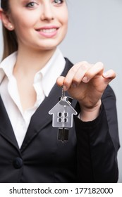 Young businesswoman giving house keys