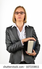 Young businesswoman with glasses looking up holding a book. Isolated on white