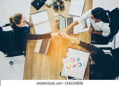 Young businesswoman going to make handshake with a businessman -greeting, dealing, merger and acquisition concepts.Happy business colleagues in modern office.