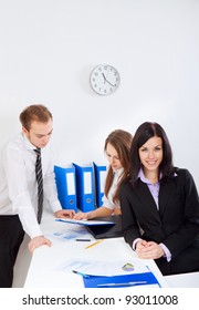 young businesswoman happy smile at office, colleagues on background people working, business man and woman discussing the problem, business plan, papers charts, document, businesspeople above top view