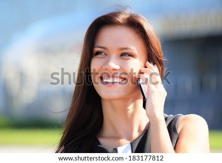 Young businesswoman having a conversation using a smartphone on a phone call