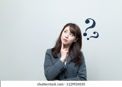 Young businesswoman having questions.