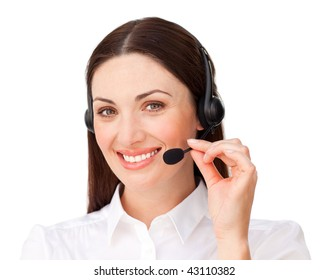 Young businesswoman with headset on smiling at the camera