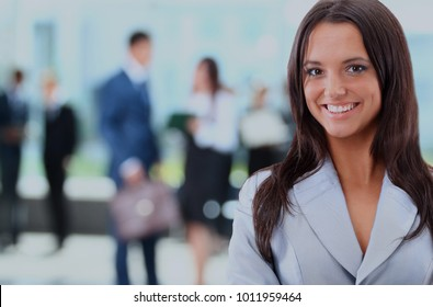 Young businesswoman and her colleagues.
