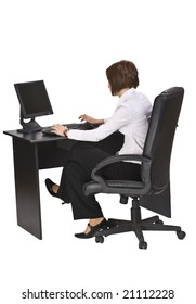 Young businesswoman at her desk working on the computer.