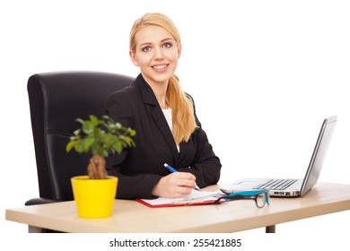 Young businesswoman in her office, white background