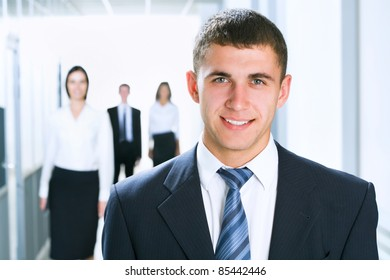 Young businesswoman and his colleagues