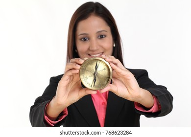 Young businesswoman holding a directional compass