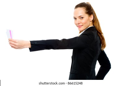 Young businesswoman holding sheets of paper on white background studio