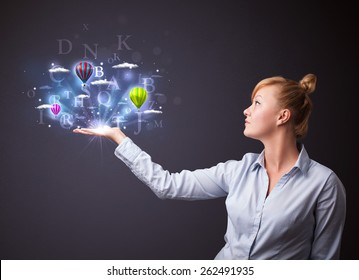 Young businesswoman holding shining letters and balloons in her hand