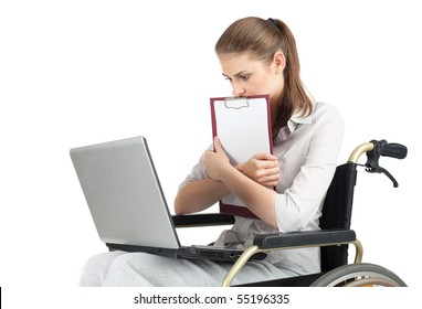 young businesswoman with laptop and clipboard on the wheelchair