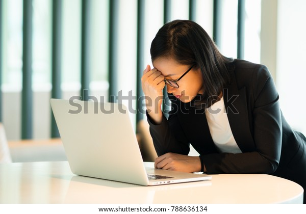 Young businesswoman with a laptop computer, Concept stock falls