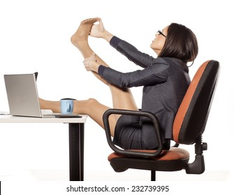 young businesswoman with legs on the table massaged her foot