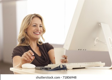 Young businesswoman looking at computer