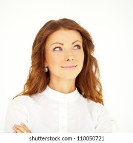 Young businesswoman looking up or corner above. Isolated against neutral background