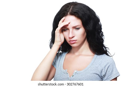 Young businesswoman looking sad against a white background