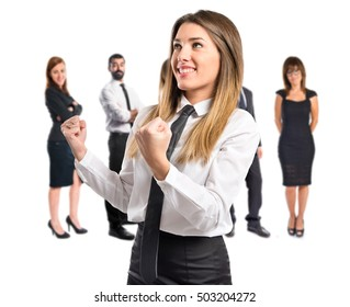 Young businesswoman with many people behind