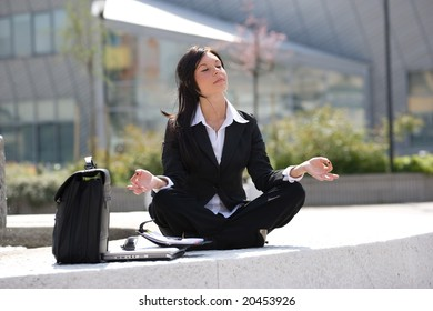 young businesswoman meditating during an office break