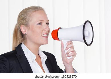 a young businesswoman with a megaphone makes an announcement