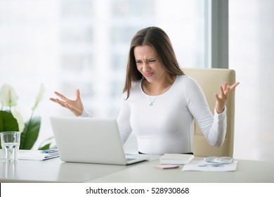 Young businesswoman at modern home office desk with laptop impressed by the bill to pay, revealed online affair, e-mail about broken romantic relationship, photo partner being unfaithful, system error