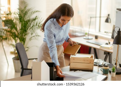 Young businesswoman organizing documents in the office