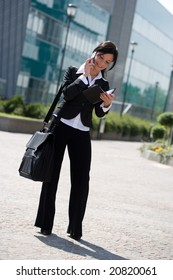 young businesswoman outdoors near to her office making a phone call