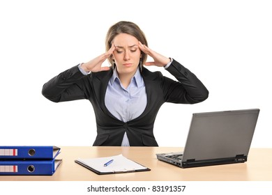 A young businesswoman in pain as a result of a headache posing isolated on white background