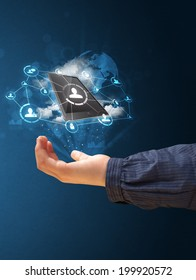 Young businesswoman presenting cloud technology in her hand