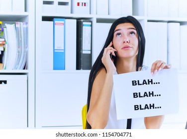 Young businesswoman in the process of useless conversation with the client or boss. Effective communication concept.