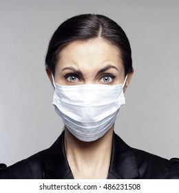 Young businesswoman with protect mask on her face