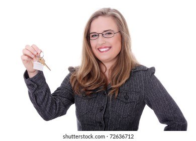 Young businesswoman (real estate agent) with house keys in hand